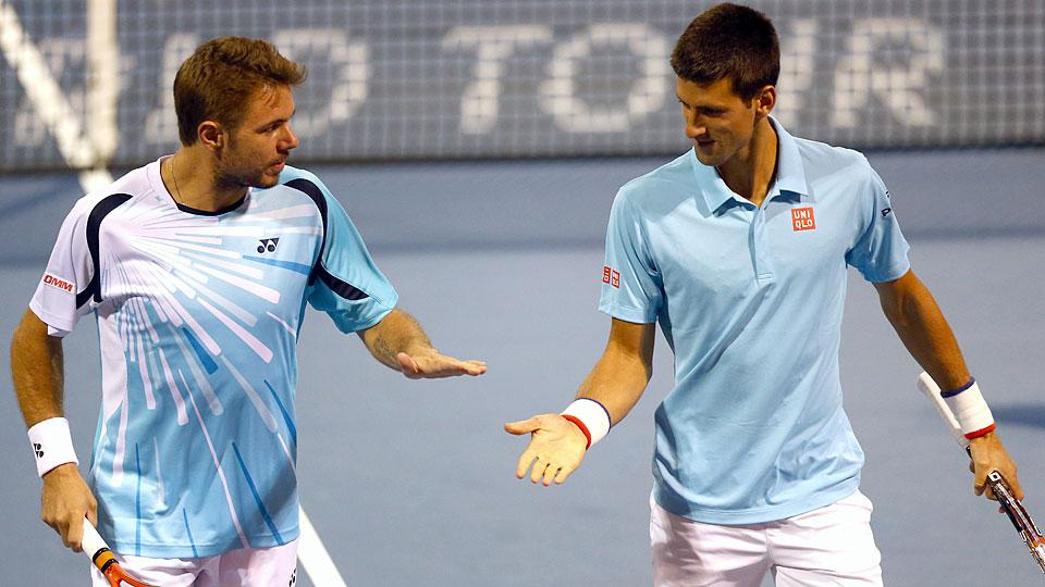 Stan Wawrinka (left) and Novak Djokovic advanced to the second round in doubles at the Rogers Cup.