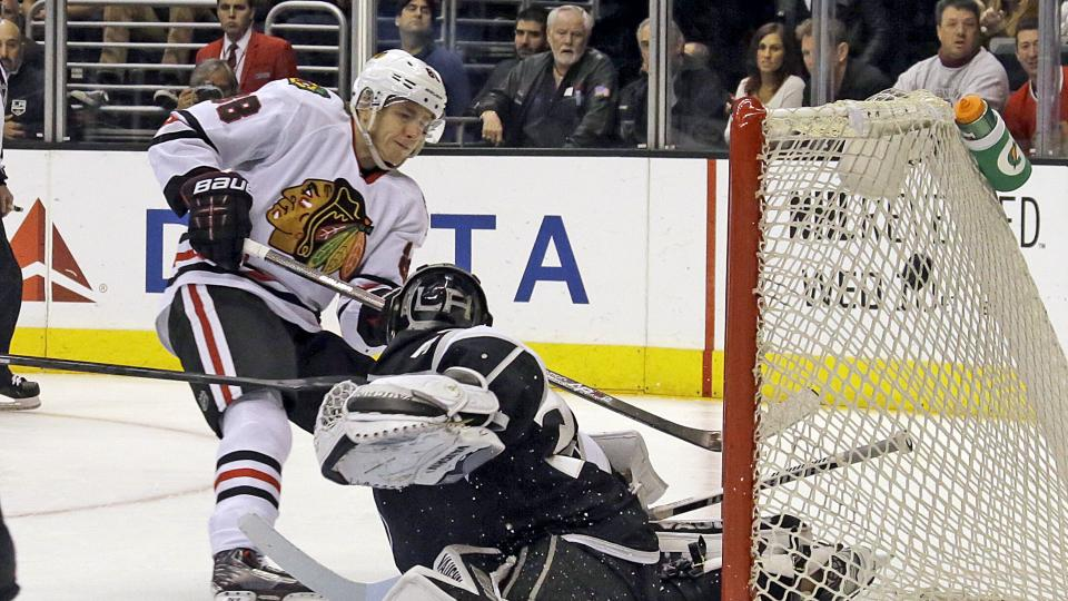 Chicago Blackhawks right winger Patrick Kane (88) tips the puck into the goal past Los Angeles Kings goalie Jonathan Quick (32) in the third period of an NHL hockey game in Los Angeles, Monday, Feb. 3, 2014. The Blackhawks won 5-3. (AP Photo/Reed Saxon)
