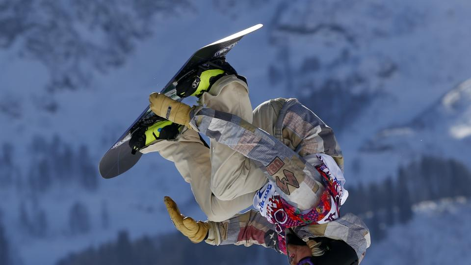 United States' Sage Kotsenburg takes a jump during the men's  snowboard slopestyle final at the Rosa Khutor Extreme Park, at the 2014 Winter Olympics, Saturday, Feb. 8, 2014, in Krasnaya Polyana, Russia. (AP Photo/Sergei Grits)