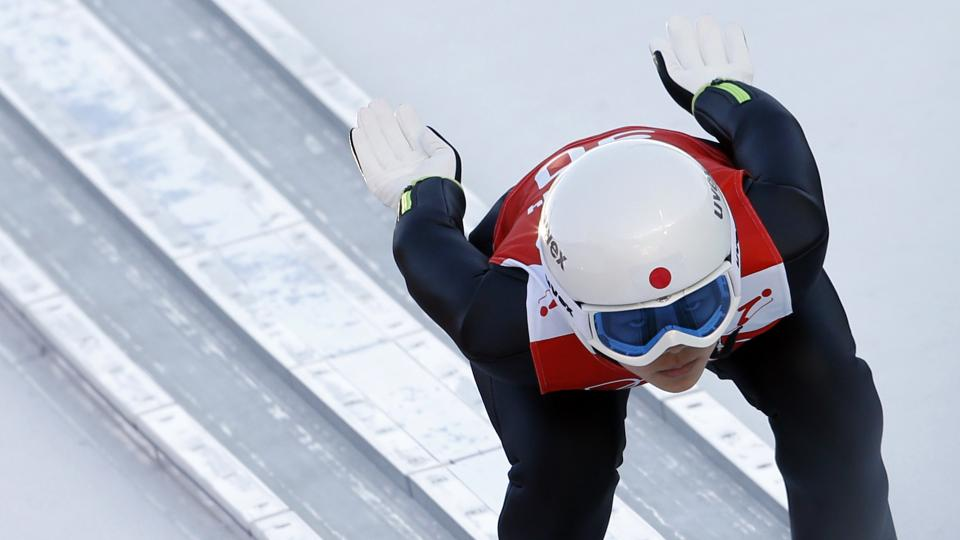 Japan's Sara Takanashi speeds down the track during a women's ski jumping training session at the 2014 Winter Olympics, Saturday, Feb. 8, 2014, in Krasnaya Polyana, Russia. (AP Photo/Matthias Schrader)