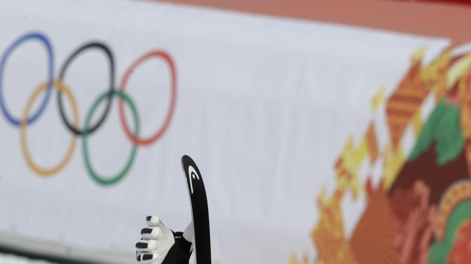 United States' Bode Miller removes his skis after finishing the men's downhill at the Sochi 2014 Winter Olympics, Sunday, Feb. 9, 2014, in Krasnaya Polyana, Russia. (AP Photo/Gero Breloer)