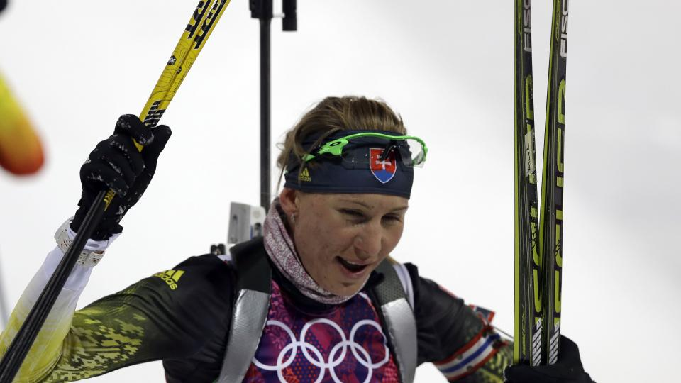 Slovakia's Anastasiya Kuzmina smiles after completing the women's biathlon 7.5k sprint and earning her second Olympic gold medal in the event.