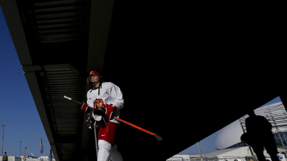 Team Russia defender Alexandra Kapustina walks under an overpass after working out during the 2014 Winter Olympics, Monday, Feb. 10, 2014, in Sochi, Russia. (AP Photo/Julio Cortez)