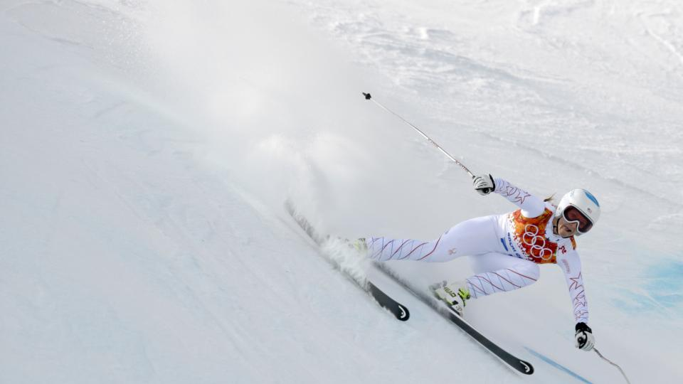 United States' Julia Mancuso makes a turn during the downhill portion of the women's supercombined at the Sochi 2014 Winter Olympics, Monday, Feb. 10, 2014, in Krasnaya Polyana, Russia. (AP Photo/Charles Krupa)