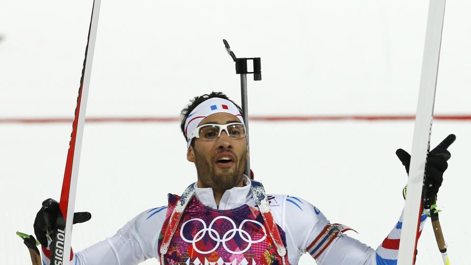 France's Martin Fourcade celebrates winning the gold during the men's biathlon 12.5k pursuit, at the 2014 Winter Olympics, Monday, Feb. 10, 2014, in Krasnaya Polyana, Russia. (AP Photo/Felipe Dana)