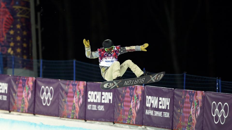 Shaun White of the United States gets air during a snowboard half pipe training session.