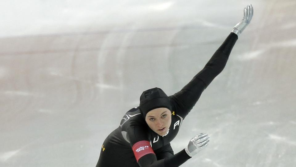 Germany's Jenny Wolf, bottom, and Heather Richardson of the U.S. compete in the first heat of the women's 500-meter speedskating race at the Adler Arena Skating Center during the 2014 Winter Olympics, Tuesday, Feb. 11, 2014, in Sochi, Russia. (AP Photo/David J. Phillip )