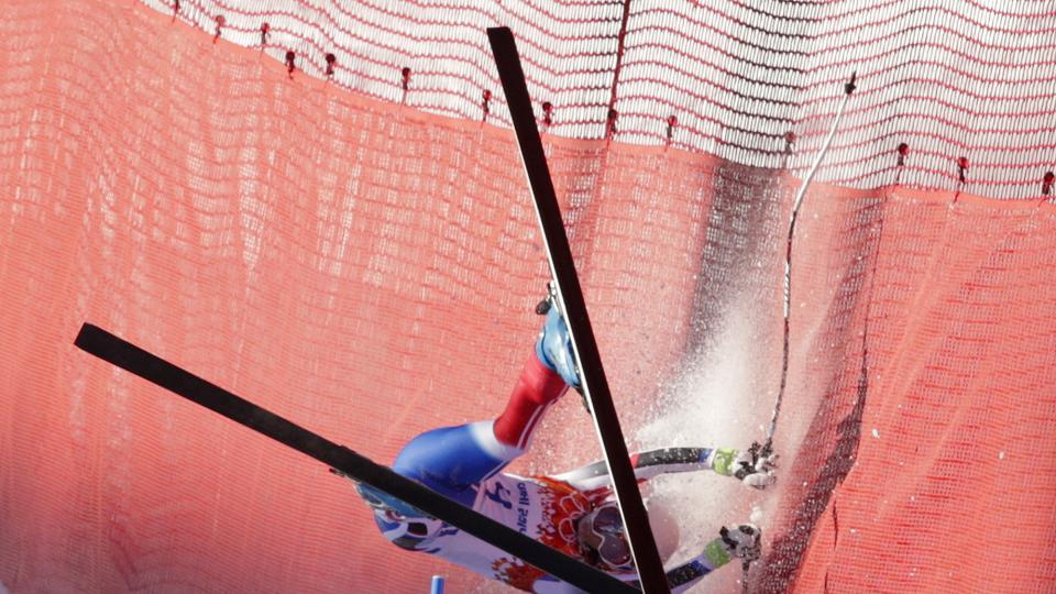 France's Marie Marchand-Arvier crashes into safety netting during the women's downhill at the Sochi 2014 Winter Olympics, Wednesday, Feb. 12, 2014, in Krasnaya Polyana, Russia. (AP Photo/Charles Krupa)