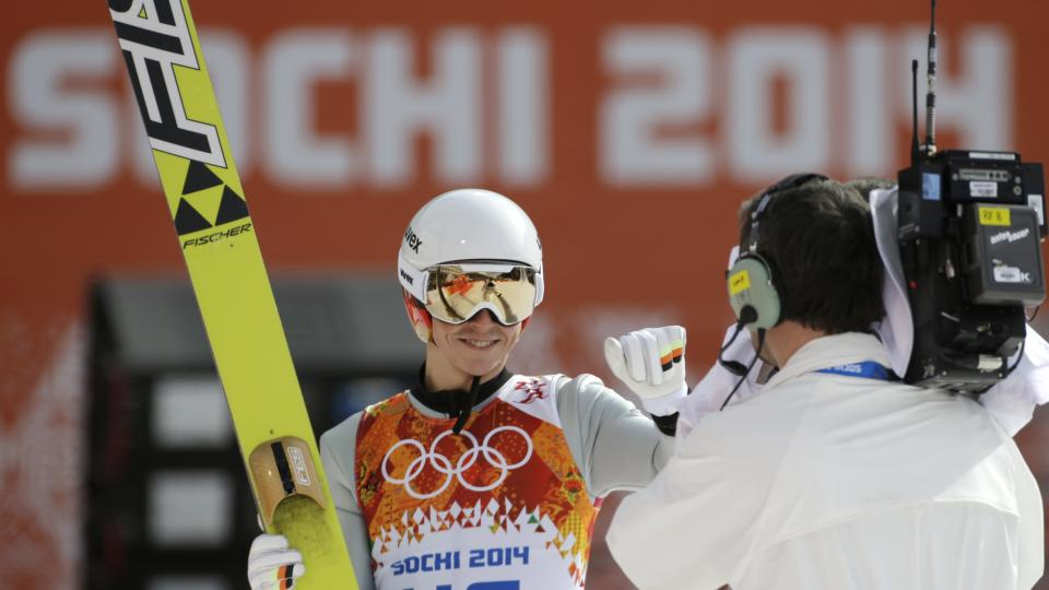 Germany's Eric Frenzel points to a camera after the ski jumping portion of the Nordic combined on Wednesday.