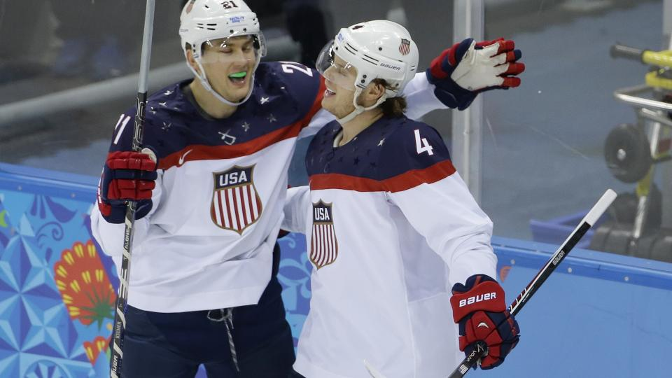 Forward James van Riemsdyk (21) congratulates defenseman John Carlson (4) for his goal against Slovakia, one of seven from the U.S on Thursday.