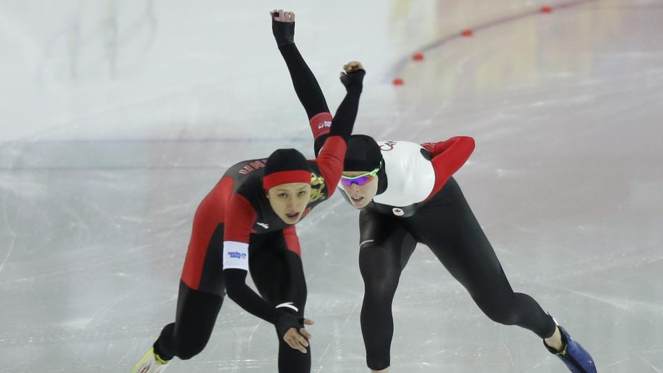 China's Zhang Hong, left, races toward her gold medal in the women's speed skating 1000 meters.