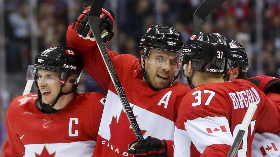 Canada's Shea Weber, center, celebrates with Sidney Crosby, left, and Patrice Bergeron after scoring a goal against Norway.