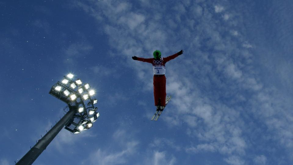 China's Li Nina jumps during women's freestyle skiing aerials training at the Rosa Khutor Extreme Park, at the 2014 Winter Olympics, Friday, Feb. 14, 2014, in Krasnaya Polyana, Russia. (AP Photo/Greg Baker)