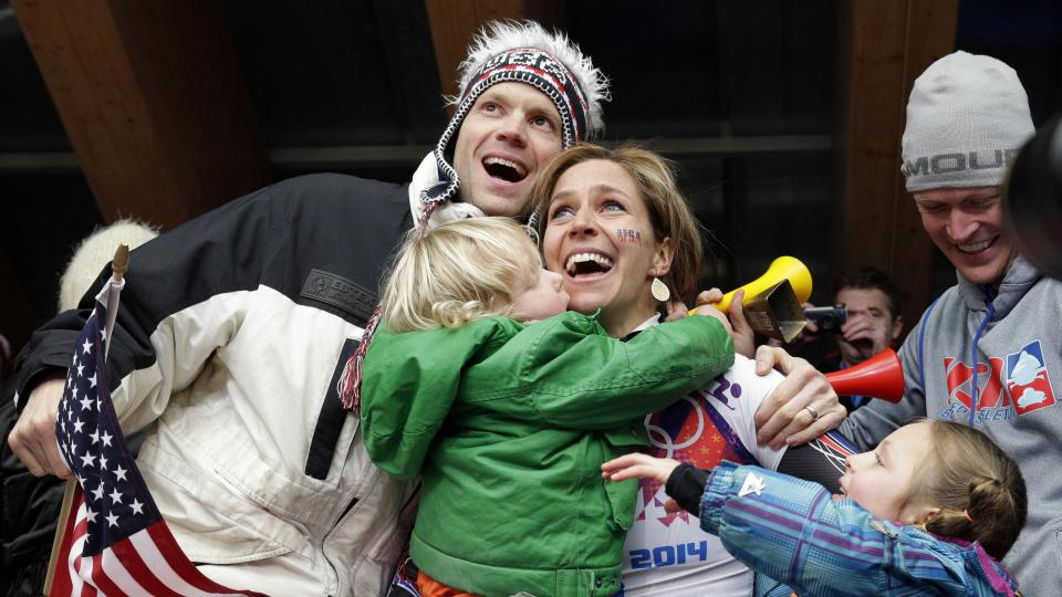 Noelle Pikus-Pace of the United States hugs her husband, Janson Pace, and children, Traycen, left, and Lacee, right, after she won the silver medal Friday.