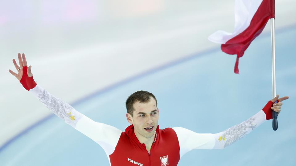 Gold medallist Poland's Zbigniew Brodka holds his national flag and celebrates after the men's 1,500-meter speedskating race at the Adler Arena Skating Center during the 2014 Winter Olympics in in Sochi, Russia, Saturday, Feb. 15, 2014. (AP Photo/Pavel Golovkin)