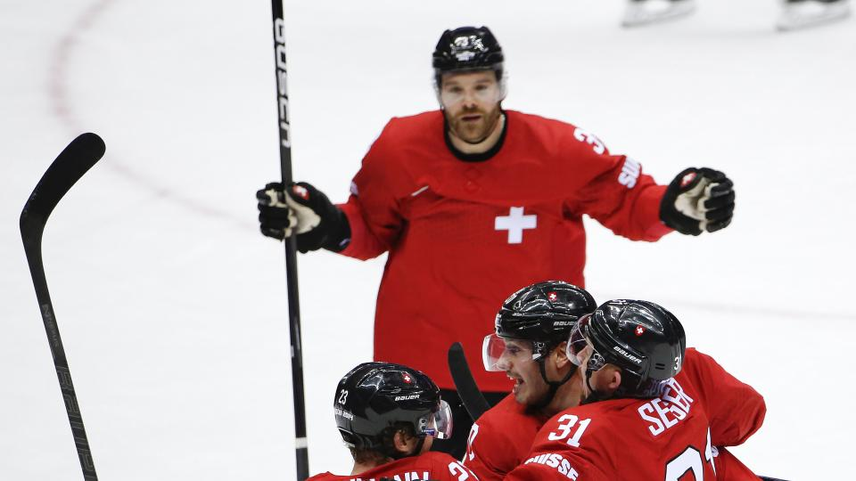 Switzerland forward Simon Bodenmann (23) celebrates with teammates after scoring a goal against the Czech Republic in the first period of a men's ice hockey game at the 2014 Winter Olympics, Saturday, Feb. 15, 2014, in Sochi, Russia. (AP Photo/Petr David Josek)