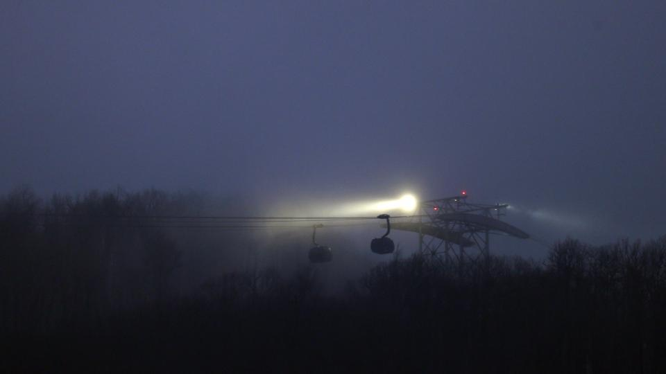 Fog rolls in over the gondola leading to the Laura Center venue and seen from the Sanki Sliding Center at the 2014 Winter Olympics, Sunday, Feb. 16, 2014, in Krasnaya Polyana, Russia. (AP Photo/Natacha Pisarenko)