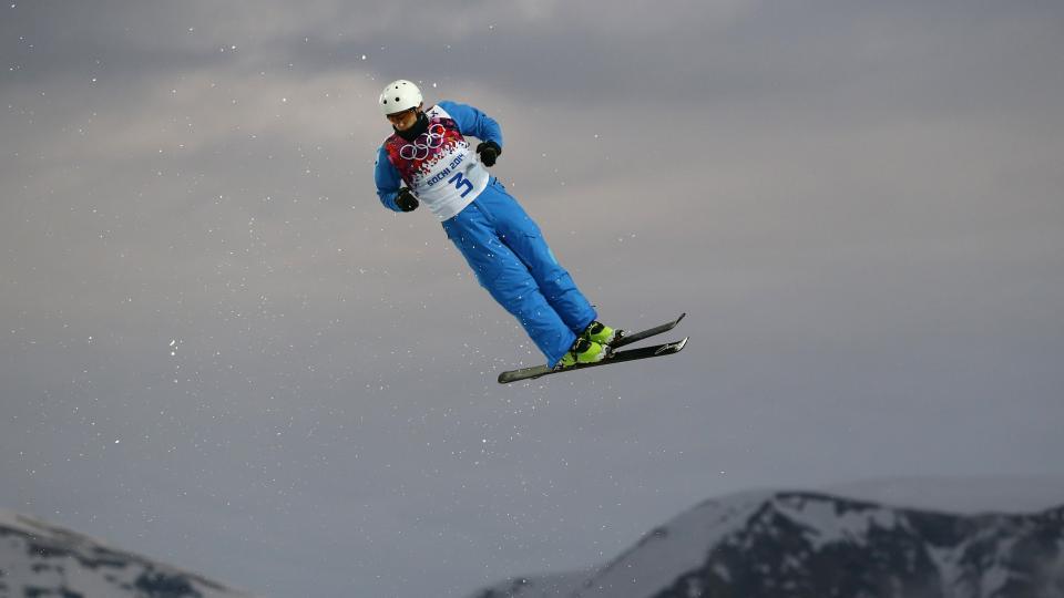 Anton Kushnir of Belarus jumps during men's freestyle skiing aerials qualifying Monday.