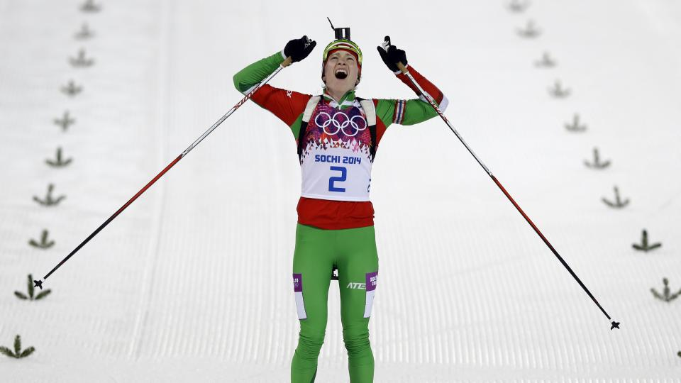 Belarus' Darya Domracheva celebrates winning the gold medal in the women's biathlon 12.5k mass-start.