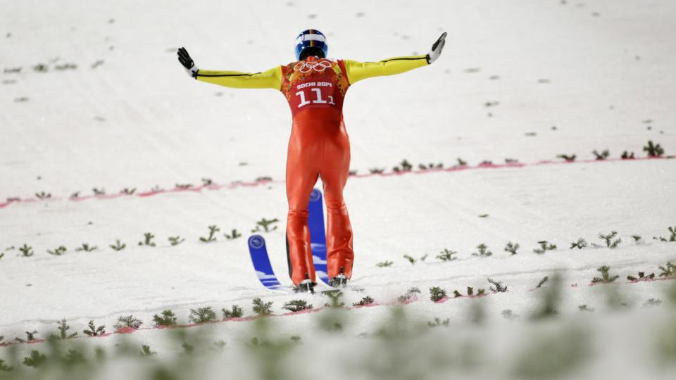 Germany's Andreas Wank lands his second attempt during the ski jumping large hill team competition Monday.