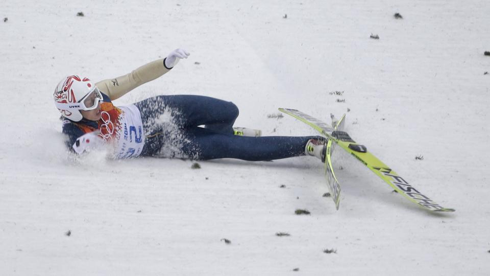 Japan's Taihei Kato falls during the Nordic combined individual Gundersen large hill competition at the 2014 Winter Olympics, Tuesday, Feb. 18, 2014, in Krasnaya Polyana, Russia. (AP Photo/Gregorio Borgia)