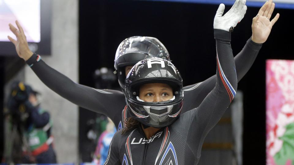 USA-1, piloted by Elana Meyers with brakeman Lauryn Williams, front, wave to fans after their first run Tuesday.