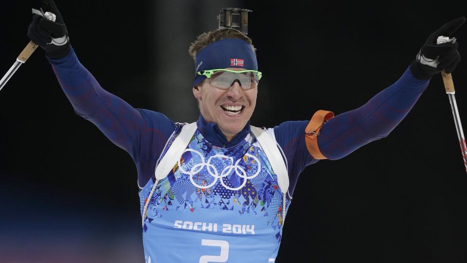 Norway's Emil Hegle Svendsen celebrates winning the gold medal during the mixed biathlon relay, at the 2014 Winter Olympics, Wednesday, Feb. 19, 2014, in Krasnaya Polyana, Russia. (AP Photo/Matthias Schrader)