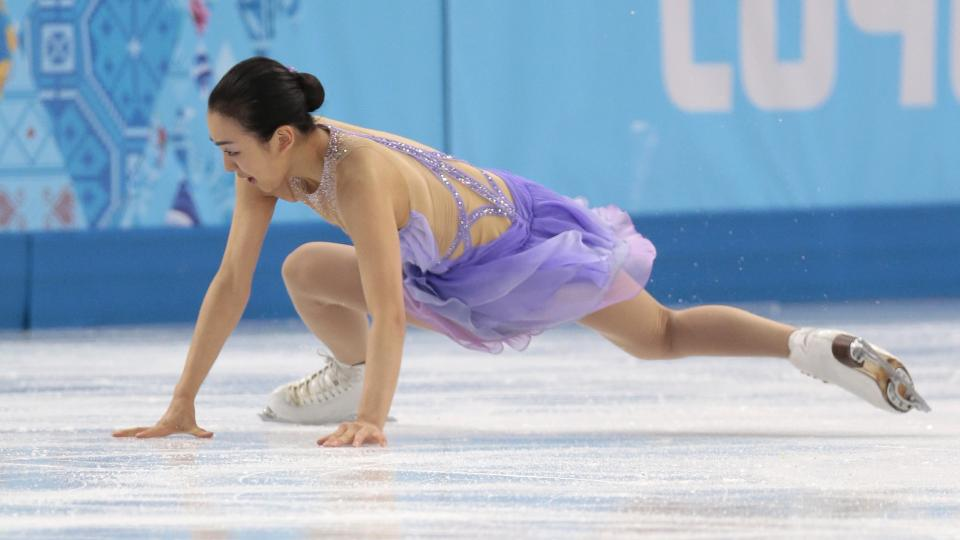 Mao Asada of Japan falls as she competes in the women's short program figure skating competition at the Iceberg Skating Palace during the 2014 Winter Olympics, Wednesday, Feb. 19, 2014, in Sochi, Russia. (AP Photo/Ivan Sekretarev)