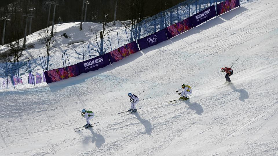 Jean Frederic Chapuis of France, left, leads compatriots Arnaud Bovolenta, second left, and Jonathan Midol, third left, and Canada's Brady Leman in the men's ski cross final at the Rosa Khutor Extreme Park, at the 2014 Winter Olympics, Thursday, Feb. 20, 2014, in Krasnaya Polyana, Russia. (AP Photo/Sergei Grits)