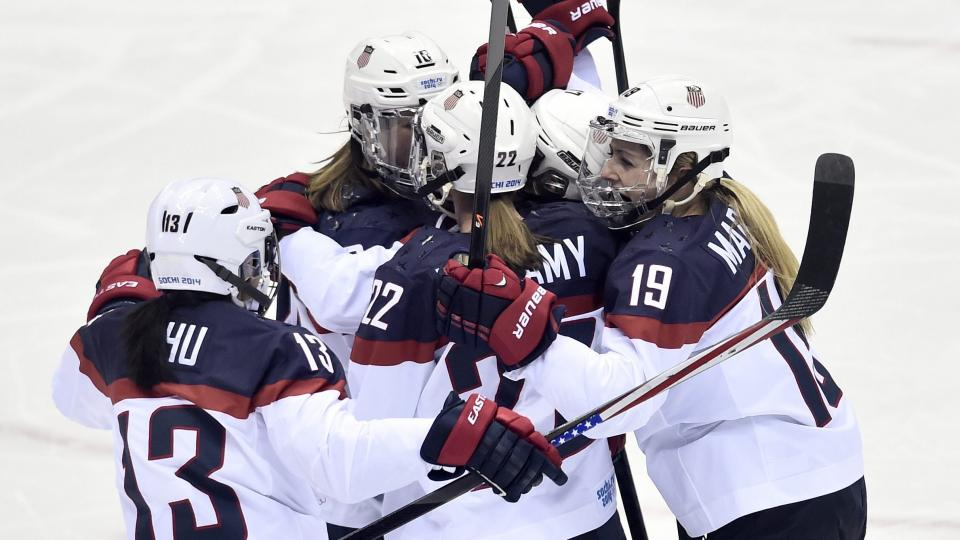 United States players  celebrate Meghan Duggan's goal against Canada during the second period of the women's gold medal ice hockey game at the 2014 Winter Olympics, Thursday, Feb. 20, 2014, in Sochi, Russia. (AP Photo/The Canadian Press, Nathan Denette)