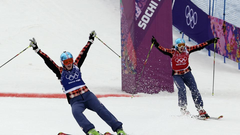 Canada's Marielle Thompson, left, celebrates winning the gold medal ahead of compatriot Kelsey Serwa right, in the women's ski cross final at the Rosa Khutor Extreme Park, at the 2014 Winter Olympics, Friday, Feb. 21, 2014, in Krasnaya Polyana, Russia. (AP Photo/Andy Wong)