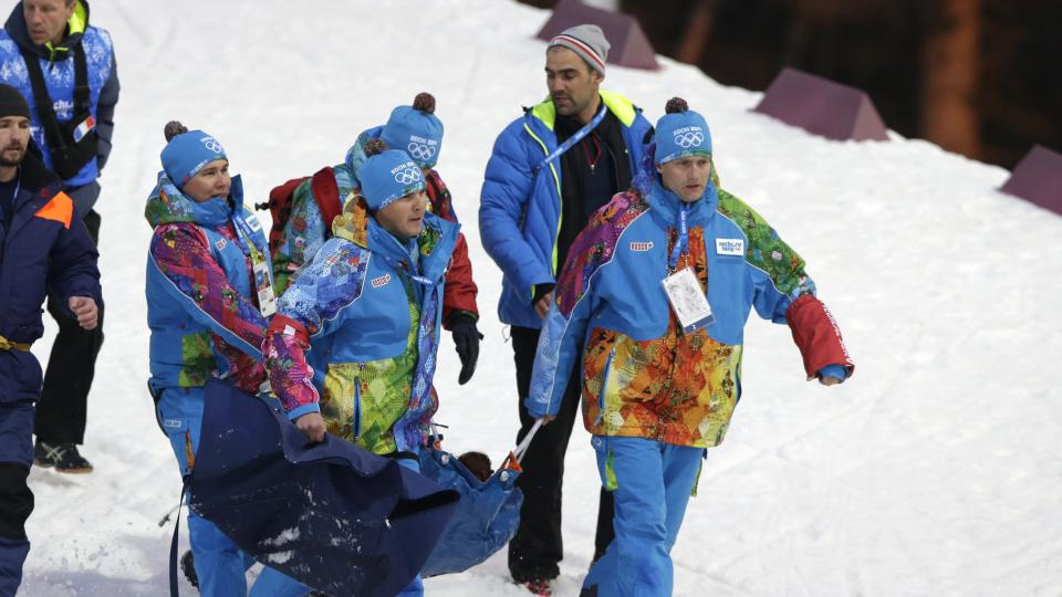 France's Marie Laure Brunet is carried away after crashing during the women's biathlon 4x6k relay at the 2014 Winter Olympics, Friday, Feb. 21, 2014, in Krasnaya Polyana, Russia. (AP Photo/Lee Jin-man)