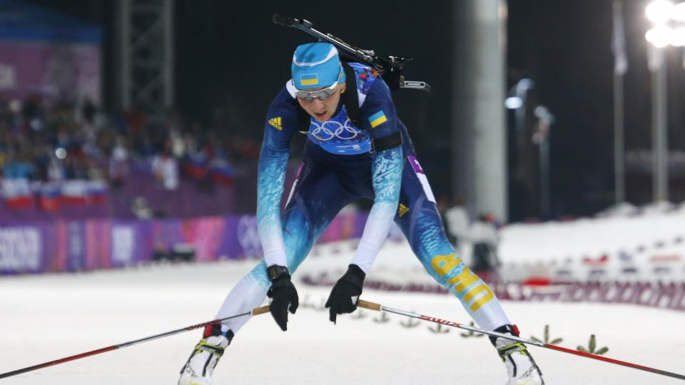 Ukraine's Olena Pidhrushna crosses the finish line to win the gold during the women's biathlon 4x6k relay, at the 2014 Winter Olympics, Friday, Feb. 21, 2014, in Krasnaya Polyana, Russia. (AP Photo/Dmitry Lovetsky)