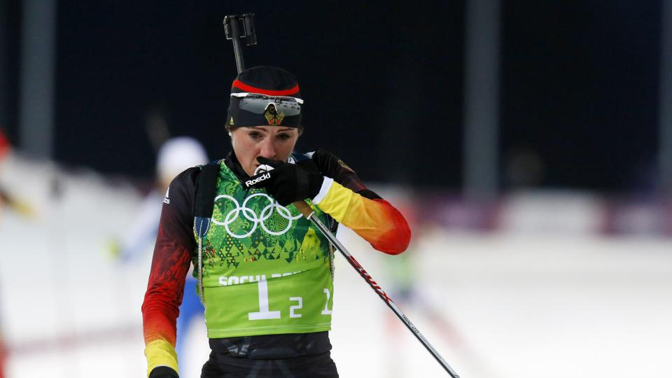 Germany's Andrea Henkel rubs her nose during the women's biathlon 4x6k relay, at the 2014 Winter Olympics, Friday, Feb. 21, 2014, in Krasnaya Polyana, Russia. (AP Photo/Dmitry Lovetsky)