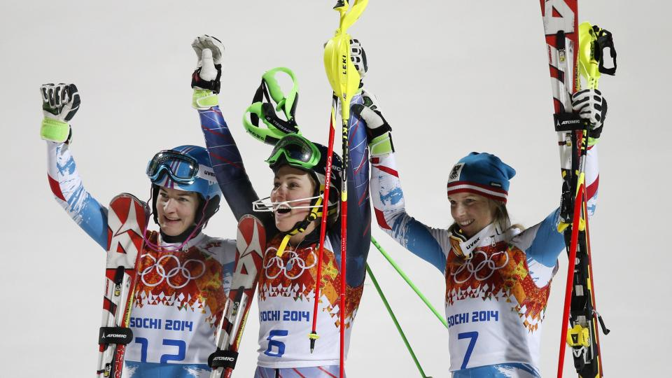 Women's slalom medialists, from left, Austria's Marlies Schild (silver) and Kathrin Zettel (bronze) and United States' Mikaela Shiffrin (gold) celebrate at the Sochi 2014 Winter Olympics, Friday, Feb. 21, 2014, in Krasnaya Polyana, Russia. (AP Photo/Christophe Ena)