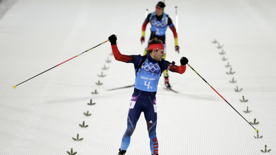 Russia's Anton Shipulin celebrates as he crosses the finish line in the men's biathlon 4x7.5K relay Saturday.