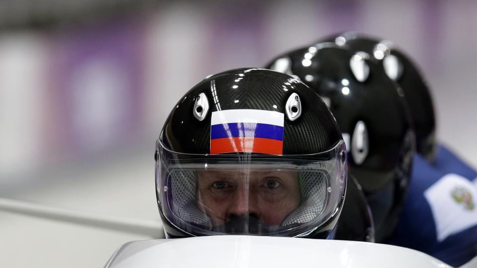 The team from Russia RUS-1, with Alexander Zubkov, Alexey Negodaylo, Dmitry Trunenkov, and Alexey Voevoda, start their first run during the men's four-man bobsled competition at the 2014 Winter Olympics, Saturday, Feb. 22, 2014, in Krasnaya Polyana, Russia. (AP Photo/Natacha Pisarenko)