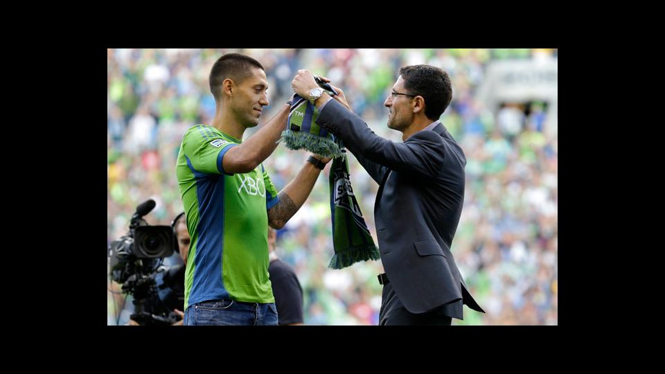 Clint Dempsey was given a soccer scarf by Sounders general manager Adrian Hanauer on Saturday.