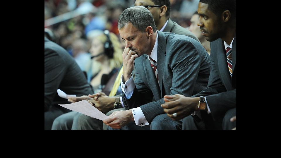 Andy Enfield (above) and Tim Floyd have been engaged in a war of words for several months.