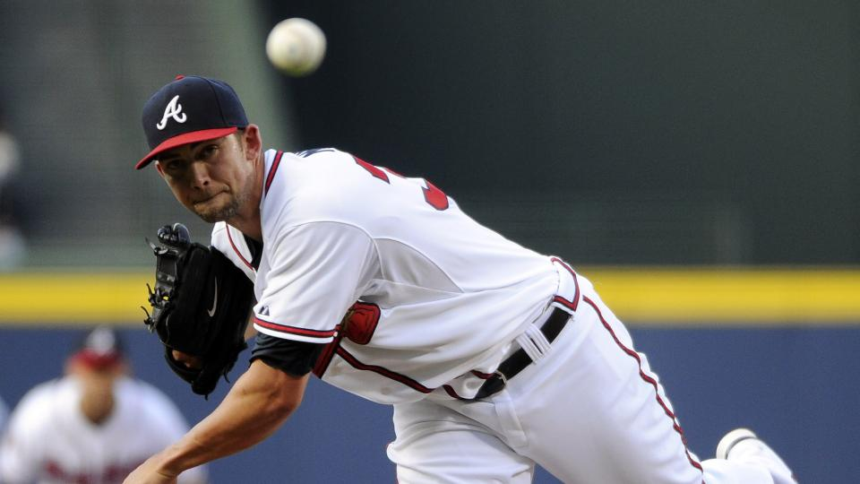 Atlanta Braves starting pitcher Mike Minor delivers to the Miami Marlins during the first inning of a baseball game Tuesday, July 22, 2014, in Atlanta. (AP Photo/David Tulis)