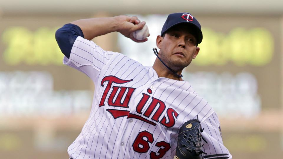 Minnesota Twins pitcher Yohan Pino throws against the Cleveland Indians in the first inning of a baseball game, Tuesday, July 22, 2014, in Minneapolis. (AP Photo/Jim Mone)