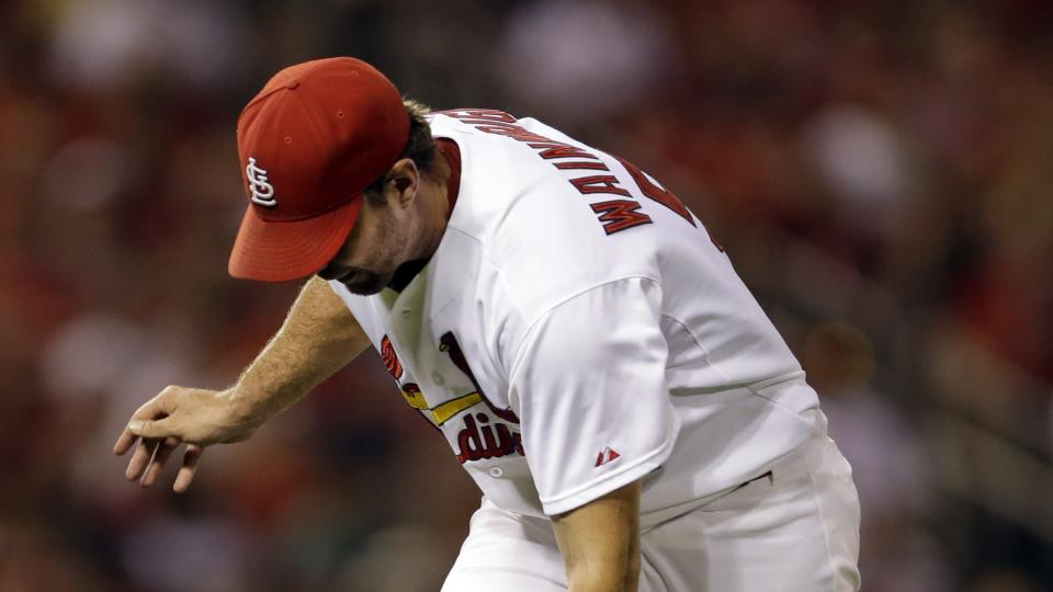 St. Louis Cardinals starting pitcher Adam Wainwright has trouble fielding a ball hit by Tampa Bay Rays' Ben Zobrist during the fifth inning of a baseball game Tuesday, July 22, 2014, in St. Louis. Wainwright was charged with an error on the play. (AP Phot