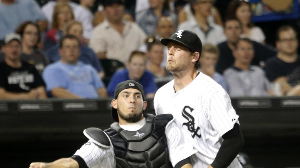 Chicago White Sox third baseman Conor Gillaspie, right, runs into catcher Adrian Nieto after Nieto fielded a bunt by Kansas City Royals' Alcides Escobar during the sixth inning of a baseball game Tuesday, July 22, 2014, in Chicago. Escobar was safe at fir