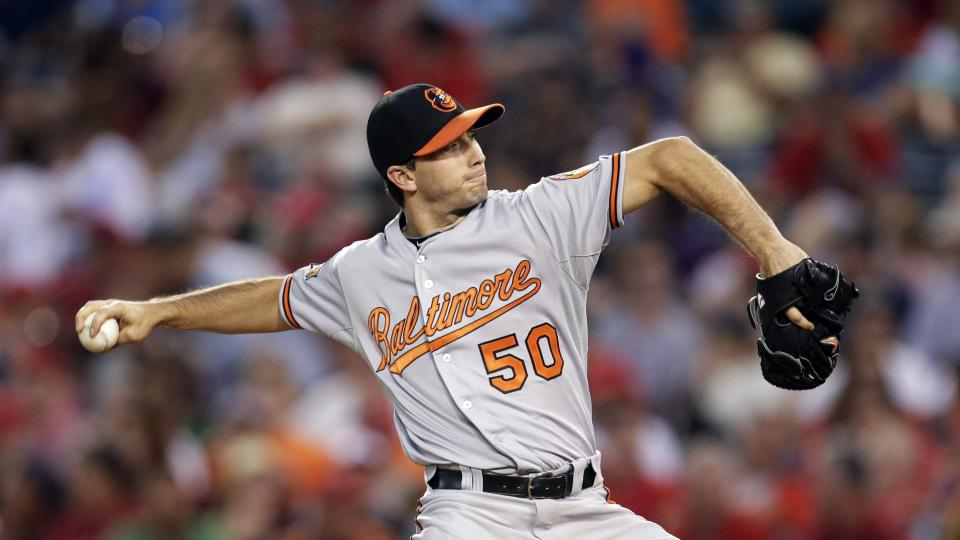 Baltimore Orioles starting pitcher Miguel Gonzalez throws against the Los Angeles Angels during the third inning of a baseball game on Tuesday, July 22, 2014, in Anaheim, Calif. (AP Photo)