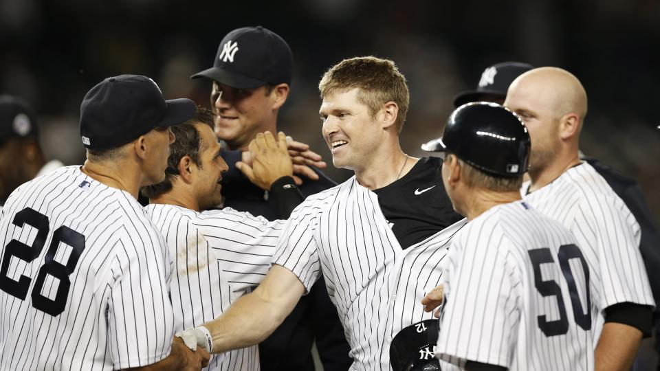 New York Yankees manager Joe Girardi (28) congratulates newly acquired New York Yankees Chase Headley, center, who hit a 14th inning, game-wimnning, walk-off RBI single to lift the Yankees to a 2-1 victory over the Texas Rangers in a baseball game at Yank