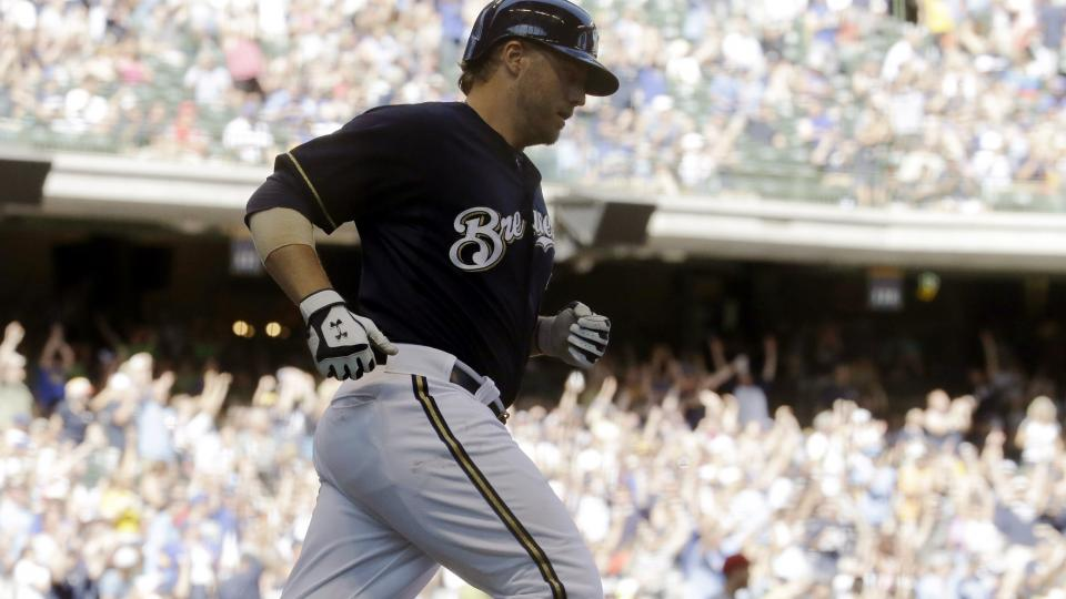 Milwaukee Brewers' Mark Reynolds rounds the bases after hitting a home run during the eighth inning of a baseball game against the Cincinnati Reds, Wednesday, July 23, 2014, in Milwaukee. (AP Photo/Morry Gash)