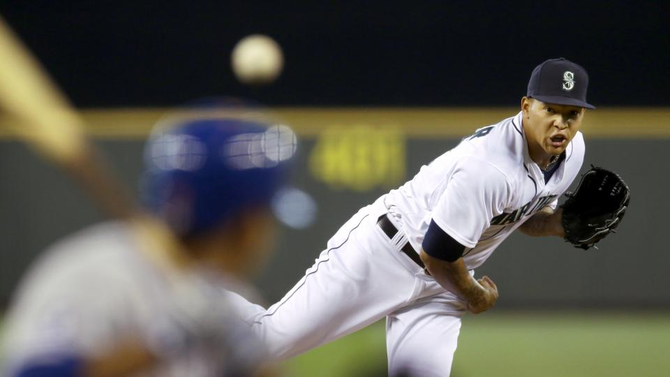 Seattle Mariners starting pitcher Taijuan Walker watches a pitch that hit New York Mets' Ruben Tejada in the helmet in the fifth inning of a baseball game, Wednesday, July 23, 2014 in Seattle. Tejada left the game and did not complete his at-bat. (AP Phot
