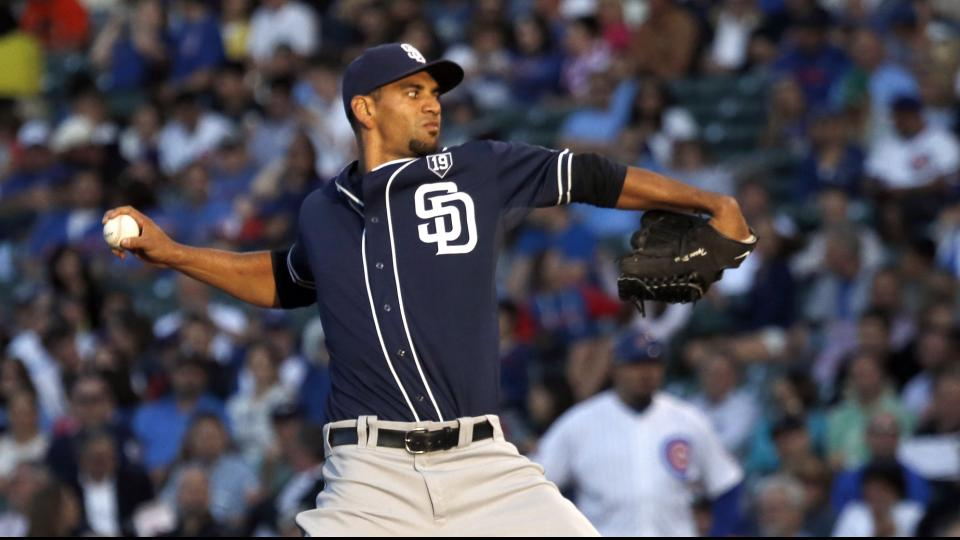 San Diego Padres starting pitcher Tyson Ross delivers as the sun sets during the first inning of a baseball game against the Chicago Cubs, Thursday, July 24, 2014, in Chicago. (AP Photo/Charles Rex Arbogast)