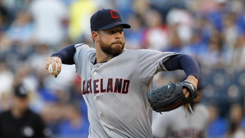 Cleveland Indians pitcher Corey Kluber throws in the first inning of a baseball game against the Kansas City Royals at Kauffman Stadium in Kansas City, Mo., Thursday, July 24, 2014. (AP Photo/Colin E. Braley)