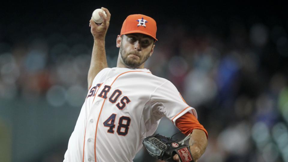 Houston Astros pitcher Jarred Cosart throws during the first inning of a baseball game against the Miami Marlins, Saturday, July 26, 2014, in Houston. (AP Photo/Patric Schneider)